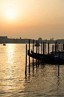 Gondolas moored at Campo della Salute on the Grand Canal at sunrise, Venice, UNESCO World Heritage Site, Veneto, Italy, Europe