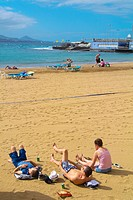 People sunbathing, Playa de las Canteras beach, Las Palmas de Gran Canaria, the Canary Islands, Spain, Europe.