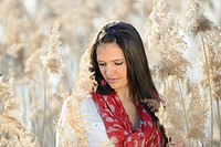 Portrait of a good looking young woman in the reeds on a sunny day in early spring.