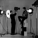 Corrado Pani poses in a photographer's studio with Joseph Walsh. The Italian voice artist and film actor Corrado Pani poses in a photographer's studio...