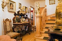 Antique furniture and furnishings adorn a hallway inside a Victorian mansion, Quebec, Canada. This image is property released. PR0103