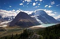 An attractive, young lady takes in the stunning view of Mount Robson, the Robson Glacier, Rearguard Mountain, Berg Lake and Berg Glacier, in the Thomp...