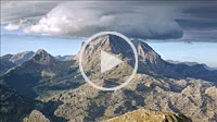Timelapse shot of low clouds sweeping the top of Puig Major mountain. Tramuntana mountains Unesco World Heritage. Majorca, Balearic islands, Spain