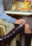 Man touching woman under the table
