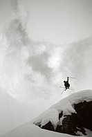 Skier Jumping from Rock, Andermatt, Uri Canton, Switzerland, Europe