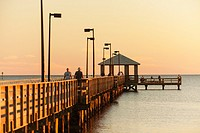 The fishing pier at sunset on the Gulf of Mexico in Biloxi, Mississippi.