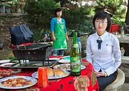 North Korean Young Woman Having Picnic In A Park, Pyongyang, North Korea.