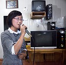North Korean Woman Singing In A Karaoke, Pyongyang, North Korea.