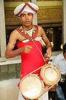 Sri Lanka; Colombo, Gangaramaya Buddhist Temple, musician, drummer,.
