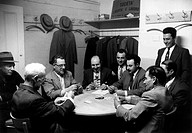 Italian-Americans playing cards. An Italian-American group playing cards at the Society for Freedom and Work among the people of Mazara di Vallo (Soci...