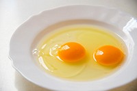 Two yolks in a dish. Close view.