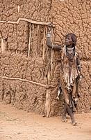 Hamer woman in her village near Turmi in the Omo Valley, Ethiopia.
