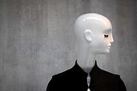 White mannequin with deep eyelash and black jacket.