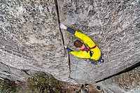 Elijah Weber rock climbing a route called Bloody Fingers which is rated 5,10 and located on Super Hits Wall at the City Of Rocks National Reserve near...