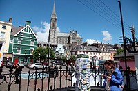 Typical street in the town of Cobh With its cathedral background, Ireland, Europe.