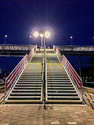 Breda, Netherlands. Stairs to an overhead traverse over the track at central railway station Breda, Netherlands, at night.