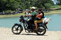 Family on a motorbike in Guatemala, Central America.