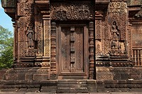 Carvings around temple doorway in Banteay Srei in Angkor in Cambodia.