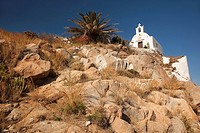White chapel on the rocks In hora, Ios, Cyclades Islands, Greek Islands, Greece, Europe.
