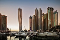 Dubai Marina at sunset with the Cayan Tower (Infinity Tower), the Dubai Marriott Harbour Hotel and Suites and various residential towers, Dubai Marina...