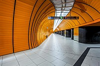 Yellow ceramic tiling and black stone finish leading to the platform of the Odeanspaltz U-Bahn station in Altstadt - Lehel, Munich, Bavaria, Germany.