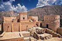 General view of Nakhl Fort, looking towards the mountains of Jebel Nakhl and the Hajar Mountain range, Nakhl, Al Batinah South Governorate, Oman.