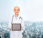 healthcare, technology, advertisement and medicine concept - smiling female doctor with stethoscope and blank black tablet pc screen
