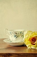 Vintage teacup and a yellow rose