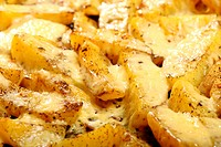 Roasted potatoes with spices and cheese