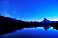 Matterhorn with Milky Way reflected in lake Stellisee, at night, Valais Alps, Canton of Valais, Zermatt, Switzerland