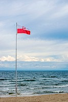 Flag of Poland at the Baltic Sea.