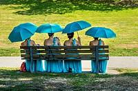 bridesmaids sit in Queen Elizabeth Park, Vancouver, BC, Canada.