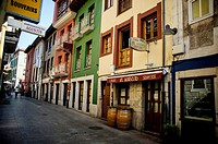 Typical streets of Llanes, with its colorful houses, Llanes, Asturias, Spain.