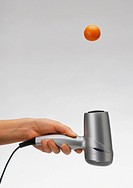 Air stream experiment using hairdryer pointed at hovering ping-pong ball.