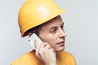Male worker talking on mobile phone