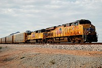 Picacho, AZ, USA - October 18, 2014: An approaching diesel locomotive pulling boxcars.