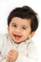 portrait of indian toddler boy laughing, fun, white.