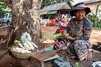Cambodia. Market near Siem Reap. Man Selling Cooked Bananas.