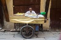 Local man selling bananas, Fes el Bali, Morocco.
