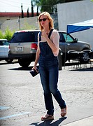 January Jones, out and about wearing denim overalls and tortoiseshell sunglasses, as she enjoys times with her son Xander, who's wearing a Beatles T-s...