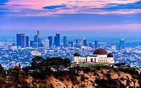 Los Angeles skyline with Griffith observatory at twilight.
