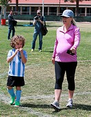 A heavily pregnant Kendra Wilkinson and husband Hank Baskett take their son, Hank Baskett IV to his football game Featuring: Kendra Wilkinson,Hank Bas...