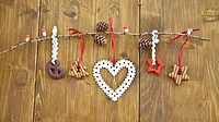 Wooden branch with christmas cookies and ornaments