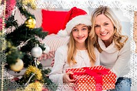 Composite image of festive mother and daughter beside christmas tree
