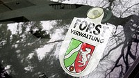 27.02.2014, Germany, Dorsten, Small shield with inscription NRW FOREST MANAGEMENT on car window . - Dorsten, Germany, 27/02/2014