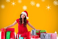 Composite image of festive brunette sitting with many shopping bags and gifts