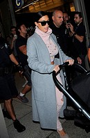 Kim Kardashian and daughter North West arrive at Los Angeles International Airport (LAX) Featuring: Kim Kardashian Where: Los Angeles, California, Uni...