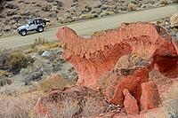 Jeep passing odd formations, Mojave Desert, California, USA.