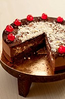 Black Forest Gateau with glace cherries, sliced