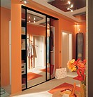 Cloakroom cupboard with mirror sliding door in hallway